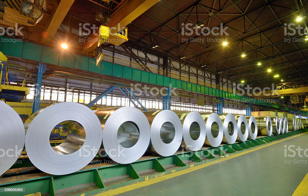 rolls of steel sheet in a plant stock photo