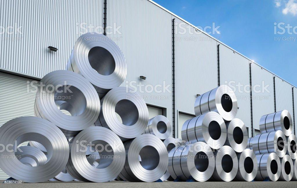rolls of steel sheet in warehouse stock photo