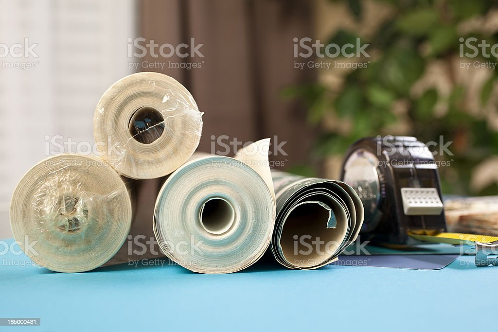 Rolls of wallpaper in home royalty-free stock photo
