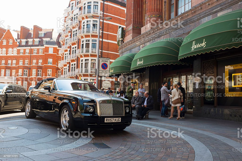 Rolls Royce parked in front of Harrods stock photo
