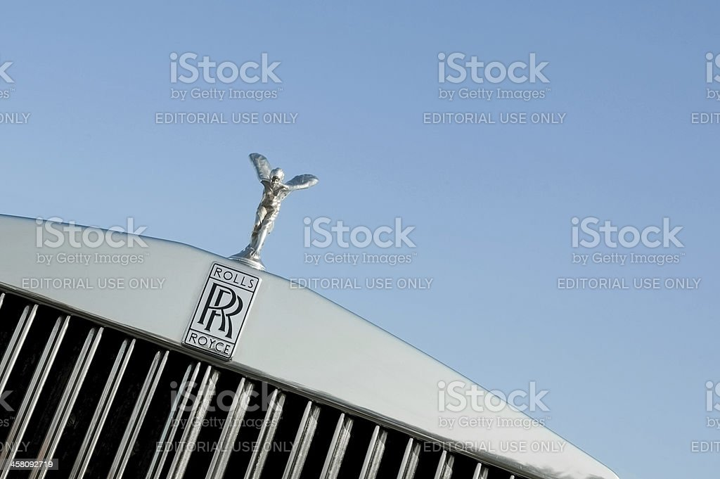 """Rolls Royce """"Rushmoor, UK - April 22, 2011: The Rolls Royce Spirit of Ecstasy vehicle hood mascot, sometimes known as The Silver Lady was designed by Charles Robinson Sykes; and is one of the worlds most recognisable corporate images."""" Angel Stock Photo"""