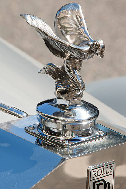 Rolls Royce Spirit of Ecstasy Hood Ornament Portland, OR, USA - July 4, 2011: The hood ornament, Spirit of Ecstasy on Rolls-Royce car parked in front of the hotel in Portlnd, Oregon. The ornament is in the form of a woman leaning forwards with her arms outstretched behind and above her. Billowing cloth runs from her arms to her back, resembling wings. royce lake stock pictures, royalty-free photos & images