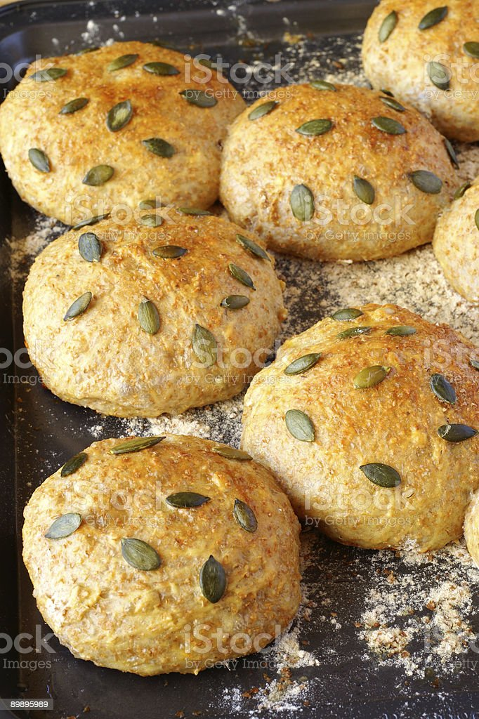 Rolls with pumpkin seed on baking tray royalty-free stock photo