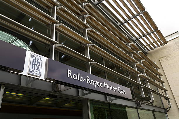 Rolls-Royce Motor Cars entrance hall at the Goodwood car factory Westhampnett, United Kingdom - August 11, 2016: Rolls-Royce Motor Cars entrance hall at the Goodwood car factory on August 11, 2016 in Westhampnett, United Kingdom. Rolls-Royce unveils new fashion inspired Dawn Couture collection. royce lake stock pictures, royalty-free photos & images