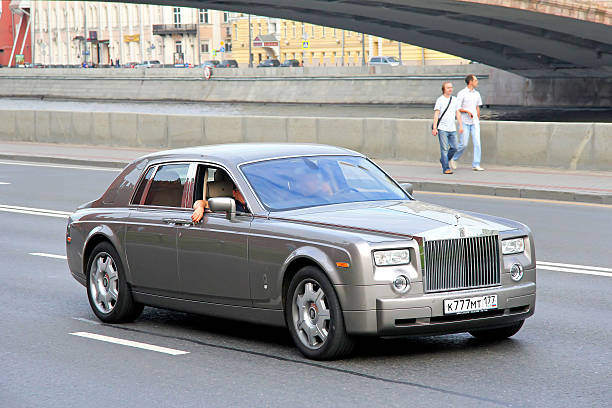 Rolls-Royce Phantom SWB Moscow. Russia - July 7, 2012: Silver premium class sedan Rolls-Royce Phantom SWB drives at the city street. royce lake stock pictures, royalty-free photos & images
