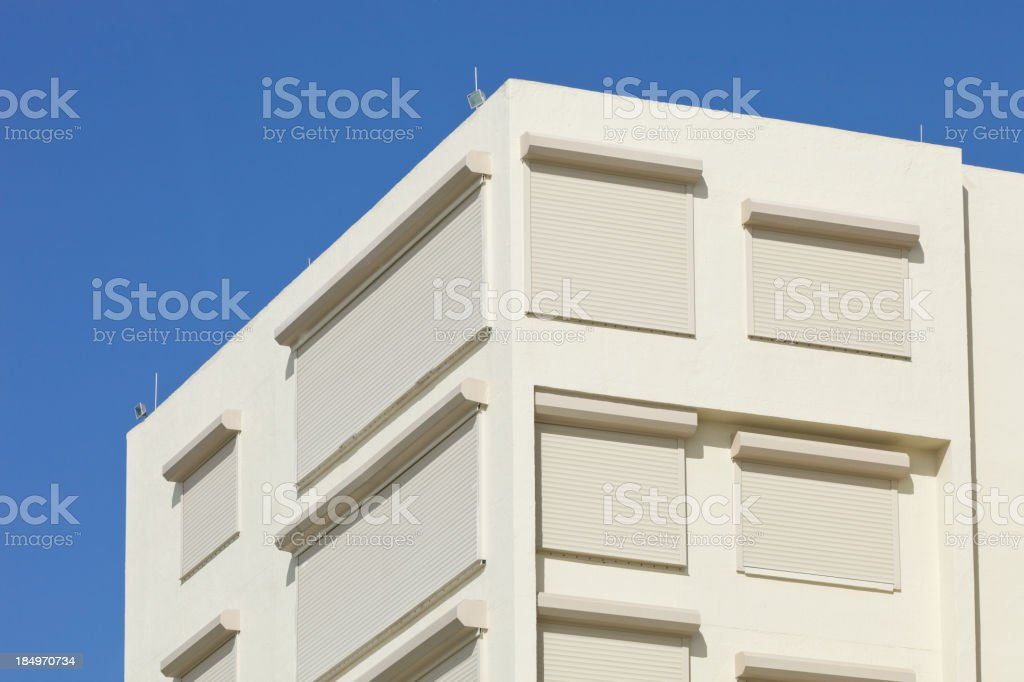 Roll-up Hurricane Shutters Installed at a Florida Coastal Building royalty-free stock photo