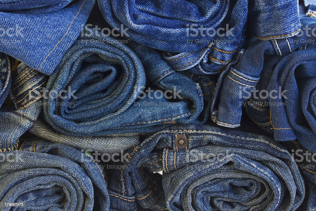 rols of jeans trousers royalty-free stock photo
