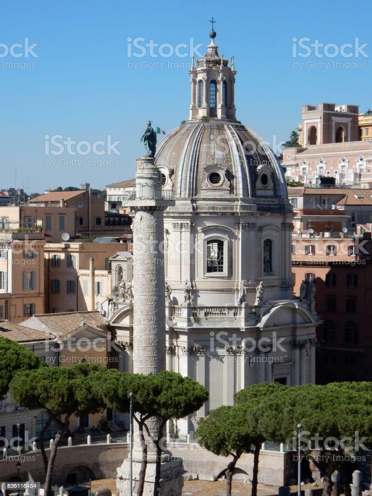 Roma - Colonna Traiana e Chiesa SS nome di Maria stock photo
