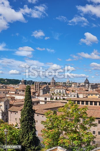 Rome, Italy, bird view to the side of Capitol Hill with ruins of the Roman Forum on the bright day