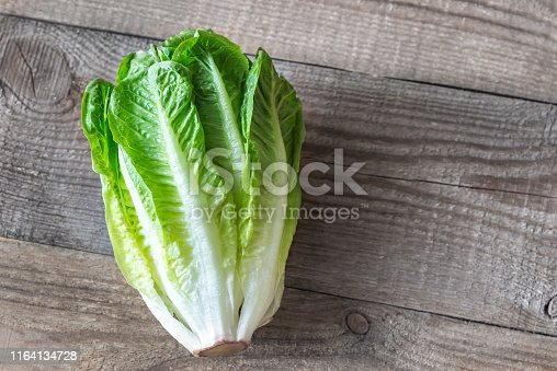 Romaine lettuce on the wooden background