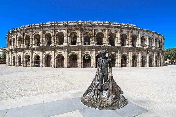 Roman Amphitheater in Nimes, France Details of Ancient Roman Amphitheater in Nimes, France amphitheater stock pictures, royalty-free photos & images