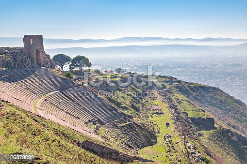 istock Roman amphitheater in the ruins of the ancient city of Pergamum known also as Pergamon with mountains in the background, Izmir, Turkey. 1126878092