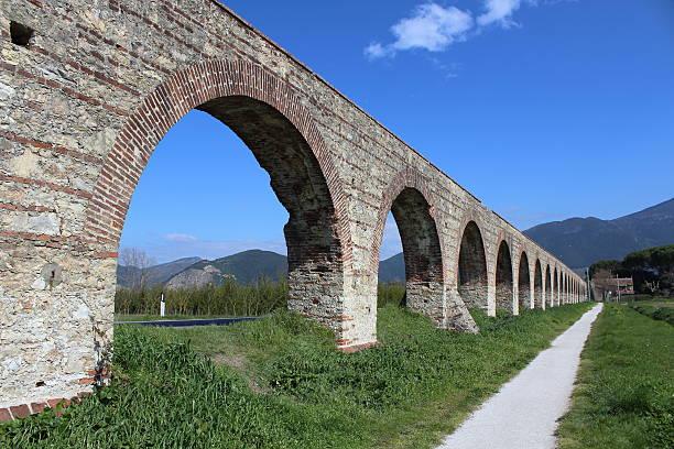 Roman Aqueduct countryside Pisa Tuscany stock photo