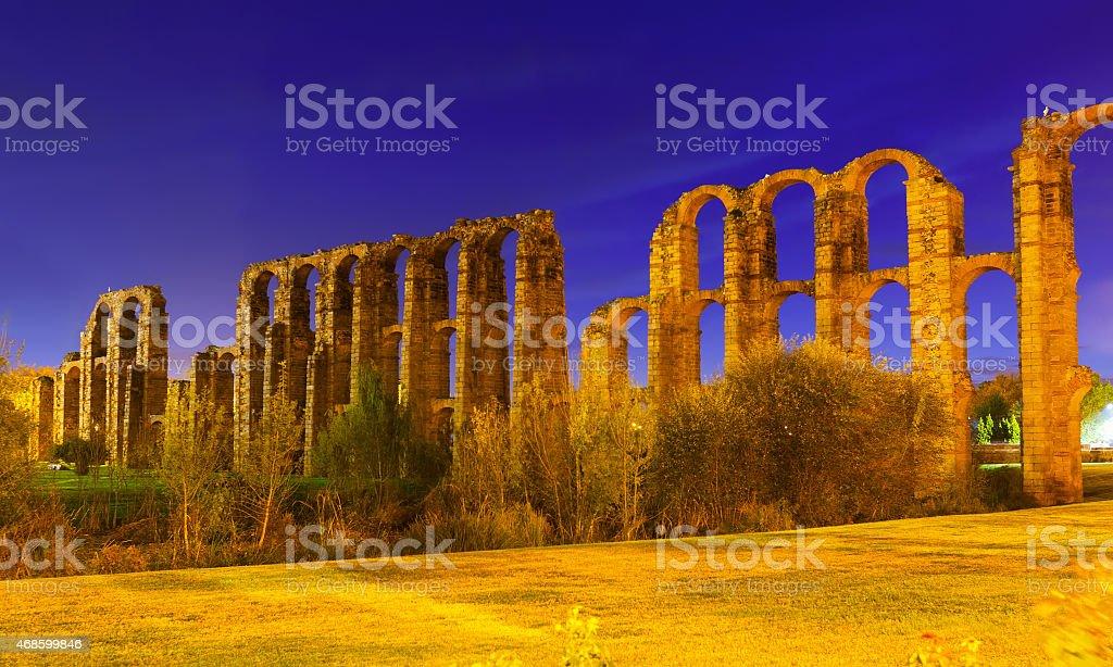 Roman Aqueduct of Merida in evening stock photo