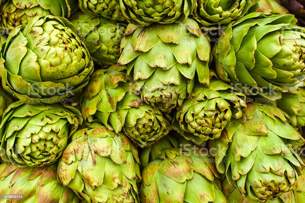 Roman Artichokes At Farmers Market Background Stock Photo Download Image Now