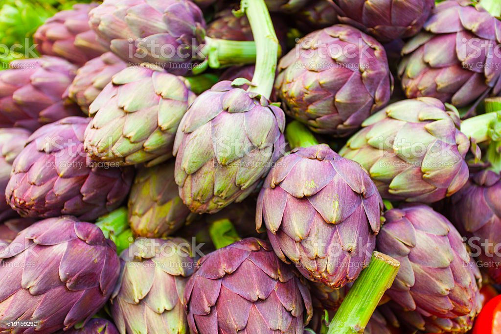 Roman Artichokes At Farmers Market Background Stock Photo