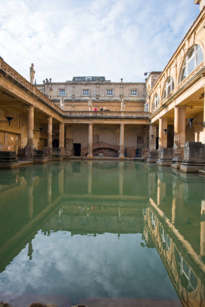 Roman Bath, Bath, England Bath, England - Nov 5, 2018: The big tub of Roman Bath. roman baths england stock pictures, royalty-free photos & images