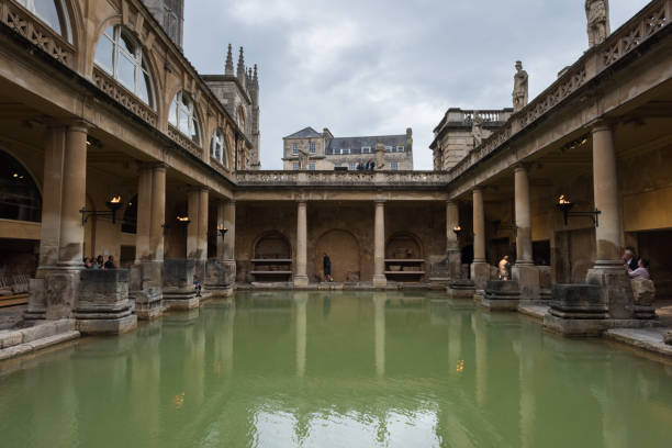 Roman Bath Bath , UK - Aug 1, 2017:  People visiting the Roman Baths  late in the day. roman baths england stock pictures, royalty-free photos & images