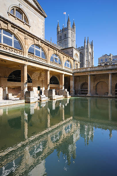 Roman Baths and Bath Abbey The famous Roman Baths with Bath Abbey in the background. XL image size, left unsharpened. roman baths england stock pictures, royalty-free photos & images