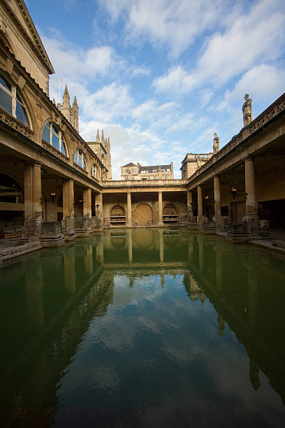 Roman Baths and Reflection Roman Baths under the blue sky and its reflection roman baths england stock pictures, royalty-free photos & images