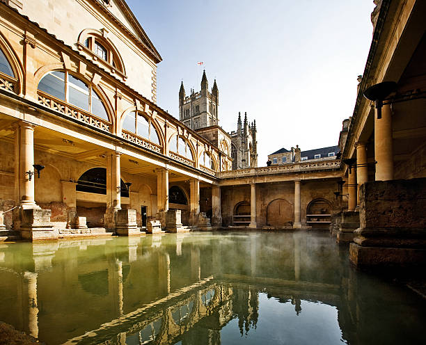 Roman Baths, Bath England Roman Baths with Bath Abbey reflection in Bath, England somerset england stock pictures, royalty-free photos & images