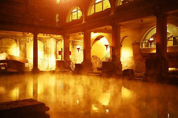 Roman Baths, Bath, England Night view of the Roman Baths, Bath, England roman baths england stock pictures, royalty-free photos & images
