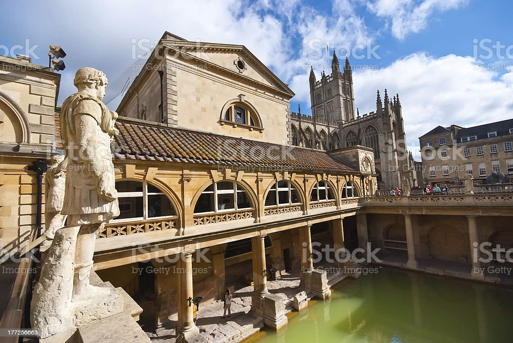 Roman baths, Bath The Ancient Roman Baths in the English city of Bath, illuminated by morning sunshine casting reflections in the thermal bath. Abbey - Monastery Stock Photo
