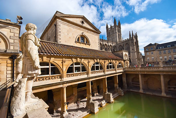 Roman baths, Bath The Ancient Roman Baths in the English city of Bath, illuminated by morning sunshine casting reflections in the thermal bath. bath england stock pictures, royalty-free photos & images