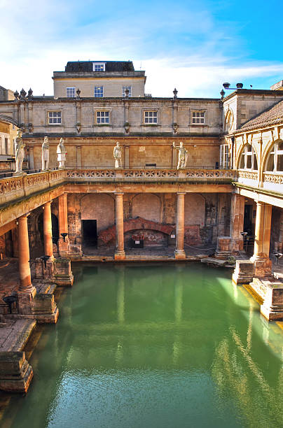 Roman Baths, Bath Spa, England View looking down over the ancient Roman Baths in Bath England which are fed by healthy mineral  spring water. bath england stock pictures, royalty-free photos & images