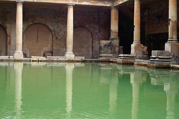 Roman baths Pool at the ruins of the roman baths. Unesco world heritage site.  roman baths england stock pictures, royalty-free photos & images