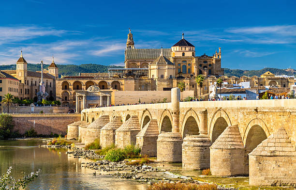 Roman Bridge across the Guadalquivir river and Mosque-Cathedral in The Roman Bridge across the Guadalquivir river and the Mosque-Cathedral in Cordoba, Spain cordoba mosque stock pictures, royalty-free photos & images