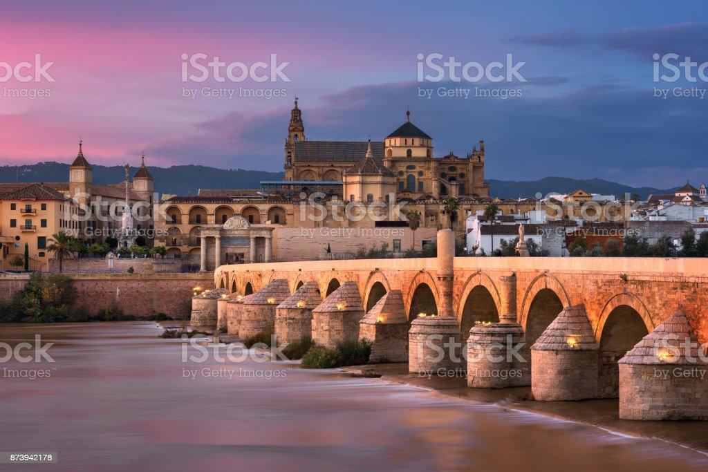 Roman Bridge and Cordoba Skyline at Sunset, Andalusia, Spain stock photo