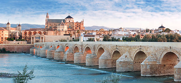 Roman Bridge and Guadalquivir river, Great Mosque, Cordoba, Spai Roman Bridge and Guadalquivir river, Great Mosque, Cordoba, Spain cordoba mosque stock pictures, royalty-free photos & images