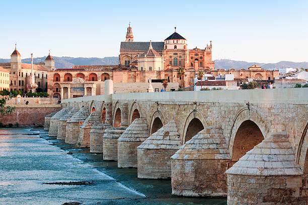 Roman Bridge and Guadalquivir river, Great Mosque, Cordoba, Spain Roman Bridge and Guadalquivir river, Great Mosque, Cordoba, Spain cordoba mosque stock pictures, royalty-free photos & images