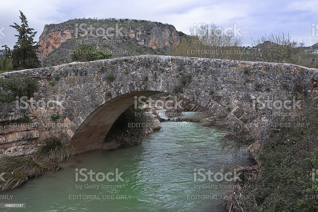 Roman bridge over the passage of Colomera river royalty-free stock photo