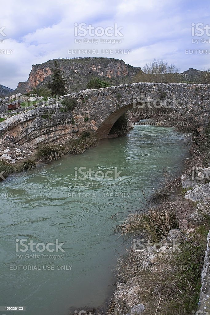 Roman bridge over the passage of Colomera river royalty-free stock photo