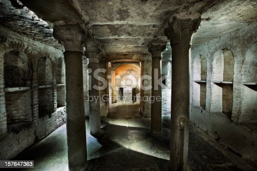 A stock photo of a tomb crypt under the Basilica of Saint Mary in Cosmedin in Rome, Italy built in the 6th century.