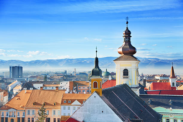 roman catholic church and old town in sibiu - romania stock photos and pictures