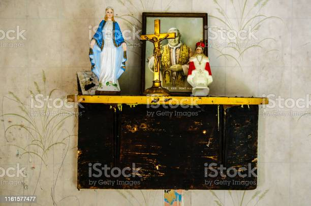 Roman Catholic religious objects on a shelf in an old Irish cottage.