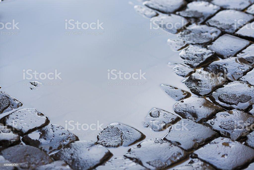 Roman cobblestone with puddle, Rome Italy stock photo