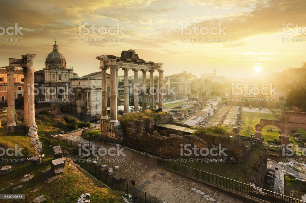 Roman Forum at sunrise, from left to right: Temple of Vespasian and Titus, church of Santi Luca e Martina, Septimius Severus Arch, ruins of Temple of Saturn. stock photo