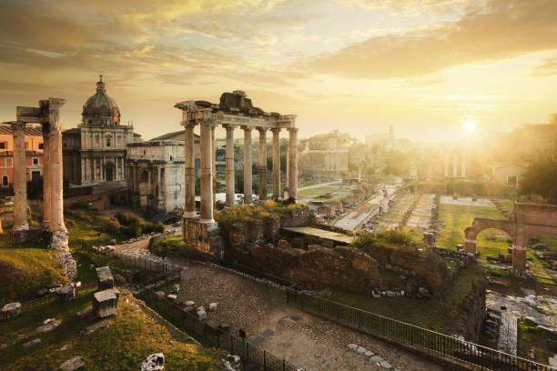 roman forum at sunrise, from left to right: temple of vespasian and titus, church of santi luca e martina, septimius severus arch, ruins of temple of saturn. - roman stock photos and pictures