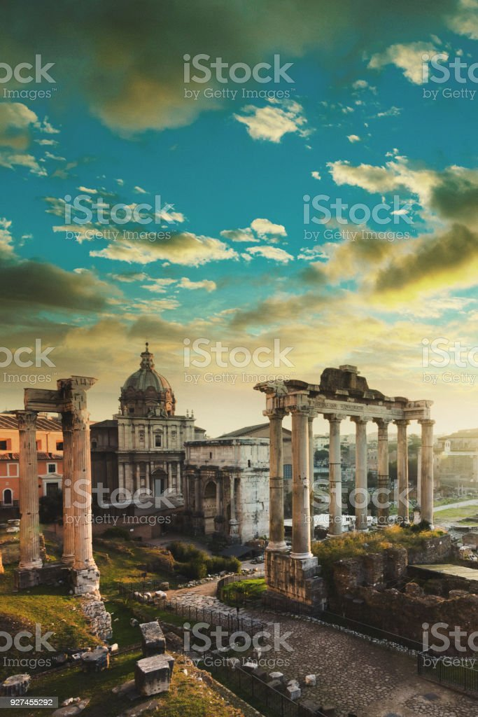 Roman Forum at sunrise, from left to right: Temple of Vespasian and Titus, church of Santi Luca e Martina, Septimius Severus Arch, ruins of Temple of Saturn stock photo