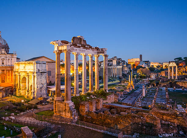 Roman Forum The Roman Forum in the evening at twilight roman forum stock pictures, royalty-free photos & images