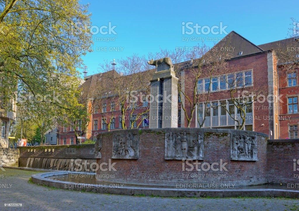 Roman fountain with Column with she-wolf on top in Cologne, Germany stock photo
