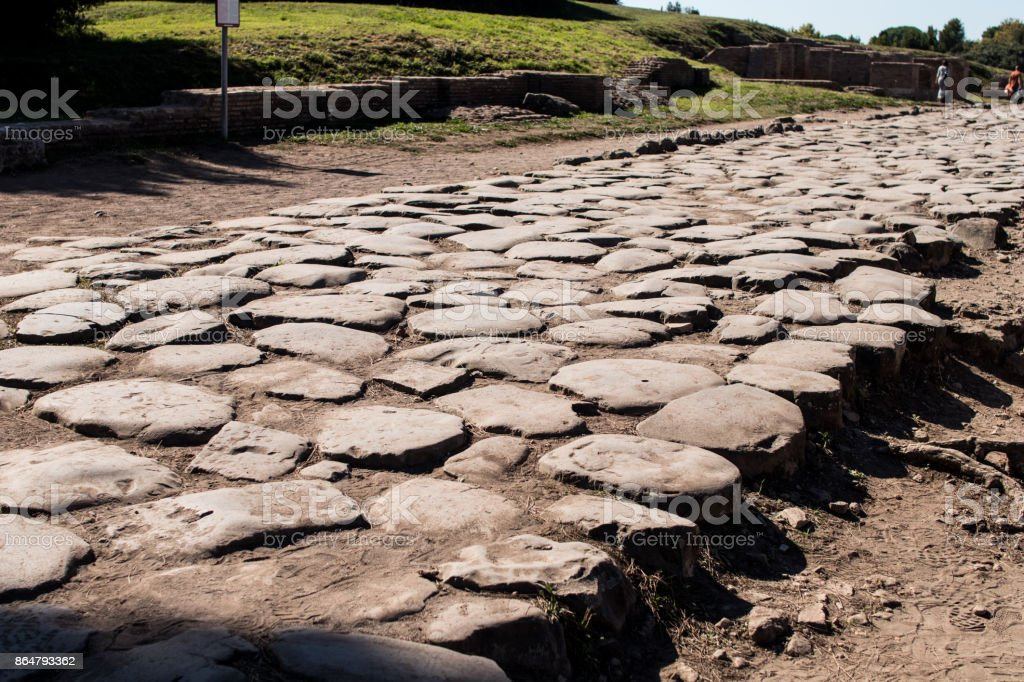 Roman road paved with big flat stones. Ostia antica Decumano maximus - foto stock