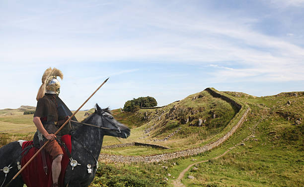 roman soldier guarding hadrians wall - roman stock photos and pictures
