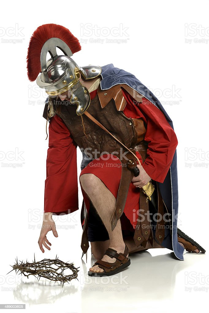 Roman Soldier Reaching For Crown of Thorns stock photo