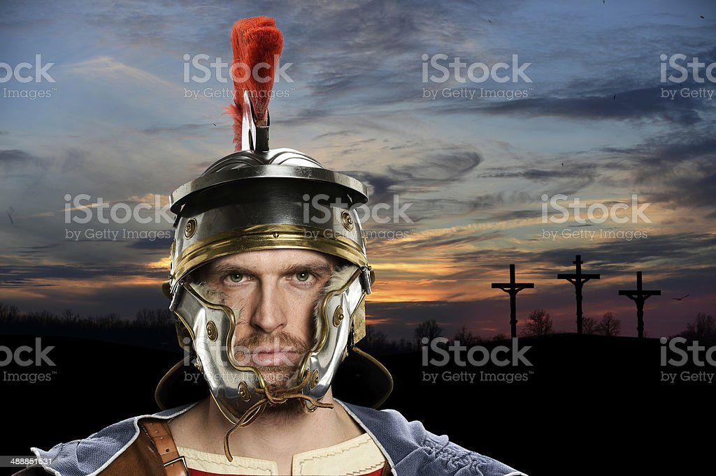 Roman Soldier With Crosses in Background stock photo