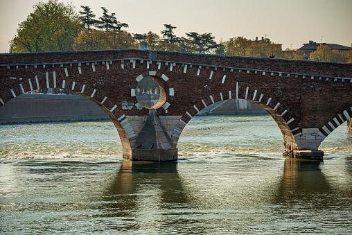 Stone bridge (Ponte Pietra) 1th century B.C. The oldest Roman monument in Verona, UNESCO world heritage site, and the river Adige, Veneto, Italy, Europe.